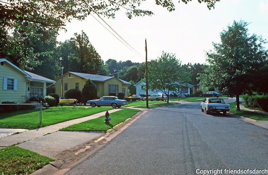 Greenbelt:  Standard Post-War World II single family houses--wider streets, sidewalks, tree-lined streets, front lawns.  Photo '85.