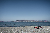 Abandoned jet ski life vest on a beach where migrants arrive from Turkey, usually at dawn so as to avoid the Greek coast guard. Turkey is only 16km away, a crossing that many attempt without traffiker assistants. Kos, Greece. Sept. 5, 2015
