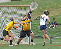 The University of Virginia women's lacrosse player Caity Whiteley, former roommate of Yeardley Love, scores a goal on Townson goalie Mary Teeters(3) during the first game since the tragic death of Virginia player Yeardley Love Sunday May 16, 2010 at Klockner Stadium in Charlottesville, Va. The Cavaliers rallied in the last four minutes to beat Towson 14-12 and reach the quarter finals of the NCAA tournament. Love's body was found May 3, and Virginia men's lacrosse player George Huguely is charged with murder. Photo/Andrew Shurtleff...