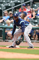 Corpus Christi Hooks first baseman Telvin Nash (23) holds a runner on during a game against the NW Arkansas Naturals on May 26, 2014 at Arvest Ballpark in Springdale, Arkansas.  NW Arkansas defeated Corpus Christi 5-3.  (Mike Janes/Four Seam Images)