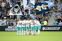 KANSAS CITY, KS - AUGUST 10: Club Leon players in a pre match huddle during a game between Club Leon and Sporting Kansas City at Children's Mercy Park on August 10, 2021 in Kansas City, Kansas.