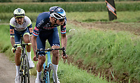 Mathieu van der Poel (NED/Alpecin-Fenix) littering<br /> <br /> Antwerp Port Epic / Sels Trophy 2021 (BEL)<br /> One day race from Antwerp to Antwerp (183km)<br /> <br /> The APC stands qualified as a 'road race', but with 36km of gravel and 28km of cobbled sections in and around the Port of Antwerp (BEL) this race occupies a unique spot in the Belgian race scene.<br /> <br /> ©kramon
