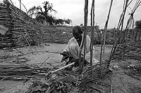 Mornei IDP camp, West Darfur, August 8, 2004.A man building his shelter. This huge camp is home to more than 75 000 IDP's.