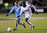 North Carolina Tar Heals Dustin McCarty (7) and Akron Zips  Darlington Nagbe (6) go for the ball. The Akron Zips defeated the North Carolina Tar Heals 5-4 in penalty kicks after playing a scoreless game during the second semi-final match of the 2009 NCAA Men's College Cup at WakeMed Soccer Park in Cary, NC on December 11, 2009.