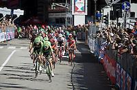 Team Cannondale-Garmin leading a 2nd peloton through the local laps in Genova<br />  <br /> 2015 Giro<br /> stage 2: Albenga - Genova (177km)