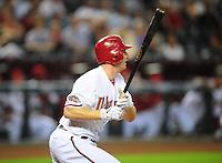 Jun. 27, 2011; Phoenix, AZ, USA; Arizona Diamondbacks shortstop Stephen Drew hits an RBI triple in the first inning against the Cleveland Indians at Chase Field. Mandatory Credit: Mark J. Rebilas-