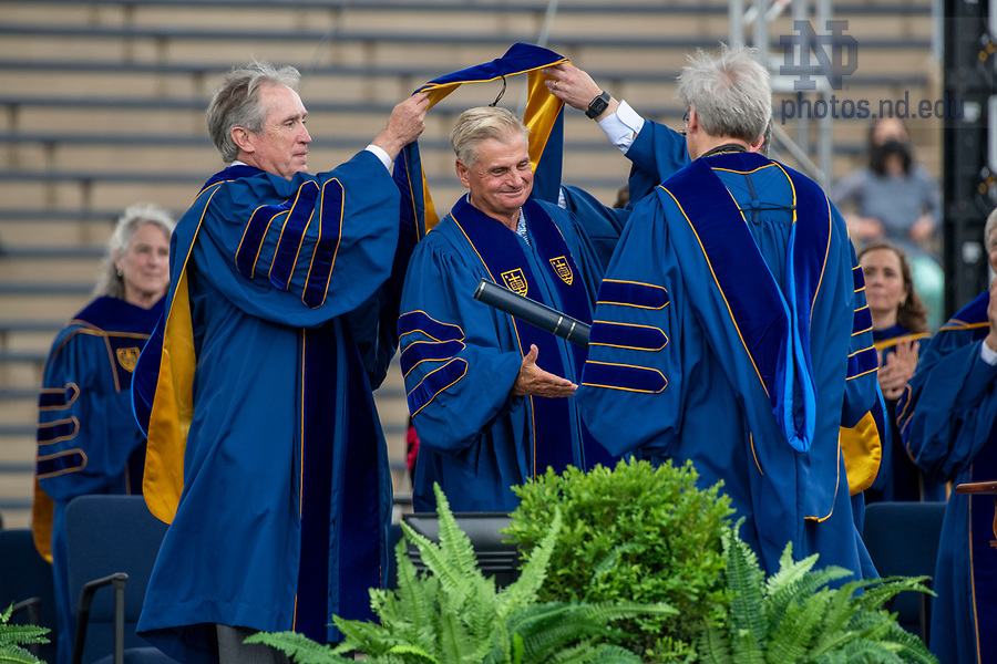 May 23, 2021;  Commencement speaker Jimmy Dunne receives his honorary doctor of laws degree during the 176th Commencement Ceremony at Notre Dame Stadium. (Photo by Barbara Johnston/University of Notre Dame)