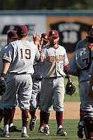 Deven Marrero #17 of the Arizona State Sun Devils greets teammates after win against the Long Beach State Dirtbags at Blair Field on March 11, 2012 in Long Beach,California. Arizona State defeated Long Beach State 6-1.(Larry Goren/Four Seam Images)