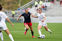 CARY, NC - APRIL 10: Ashley Hatch #33 of the Washington Spirit defends against Meredith Speck #25 of the NC Courage during a game between Washington Spirit and North Carolina Courage at Sahlen's Stadium at WakeMed Soccer Park on April 10, 2021 in Cary, North Carolina.