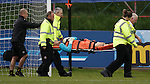 Partick Keeper Scott Fox stretchered off with his right leg in a splint