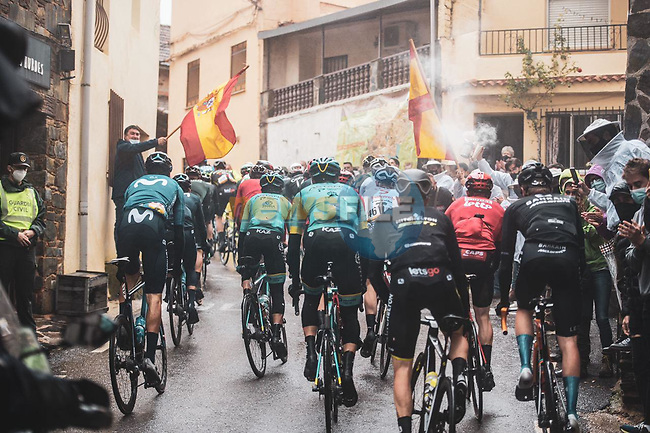The 35 man breakaway group pass through Candelario during Stage 17 of the Vuelta Espana 2020, running 178.2km from Sequeros to Alto de la Covatilla, Spain. 7th November 2020.  <br /> Picture: Unipublic/Charly Lopez | Cyclefile<br /> <br /> All photos usage must carry mandatory copyright credit (© Cyclefile | Unipublic/Charly Lopez)