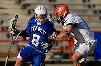 Ryan Nizolek (24) of Virginia checks Max Quinzani (8) of Duke during the ACC men's lacrosse tournament semifinals in College Park, MD.  Virginia defeated Duke, 16-12.