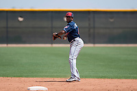 Cleveland Indians second baseman Jhan Rodriguez (4) prepares to make a throw to first base during an Extended Spring Training game against the Arizona Diamondbacks at the Cleveland Indians Training Complex on May 27, 2018 in Goodyear, Arizona. (Zachary Lucy/Four Seam Images)
