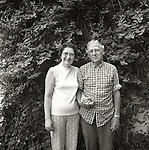 Portrait of couple in front of honeysuckle vine. 1976