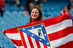 Atletico de Madrid's supporter holds a flag before quarterfinal first leg Champions League soccer match at Vicente Calderon stadium in Madrid, Spain. April 14, 2015. (ALTERPHOTOS/Victor Blanco)