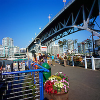 Vancouver, BC, British Columbia, Canada - Tourists visiting Granville Island under Granville Street Bridge