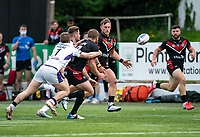 Rhys Curran of London Broncos feeds Abbas Miski of London Broncos to score his try during the Betfred Championship match between London Broncos and Newcastle Thunder at The Rock, Rosslyn Park, London, England on 9 May 2021. Photo by Liam McAvoy.