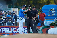 Myrtle Beach Pelicans manager Steve Lerud (39) argues with umpires Mark Bass (center) and Jake Bruner during the game against the Winston-Salem Dash at TicketReturn.com Field on May 16, 2019 in Myrtle Beach, South Carolina. The Dash defeated the Pelicans 6-0. (Brian Westerholt/Four Seam Images)