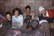 Bogota, Colombia - The Gamines are abandoned kids at the age of 5 - 10 living in the streets of Bogota. They are robbers, beggers and addicted to sniffing gazoline. At night they all sleep together in city sewers. Child labor as seen around the world between 1979 and 1980 - Photographer Jean Pierre Laffont, touched by the suffering of child workers, chronicled their plight in 12 countries over the course of one year.  Laffont was awarded The World Press Award and Madeline Ross Award among many others for his work.