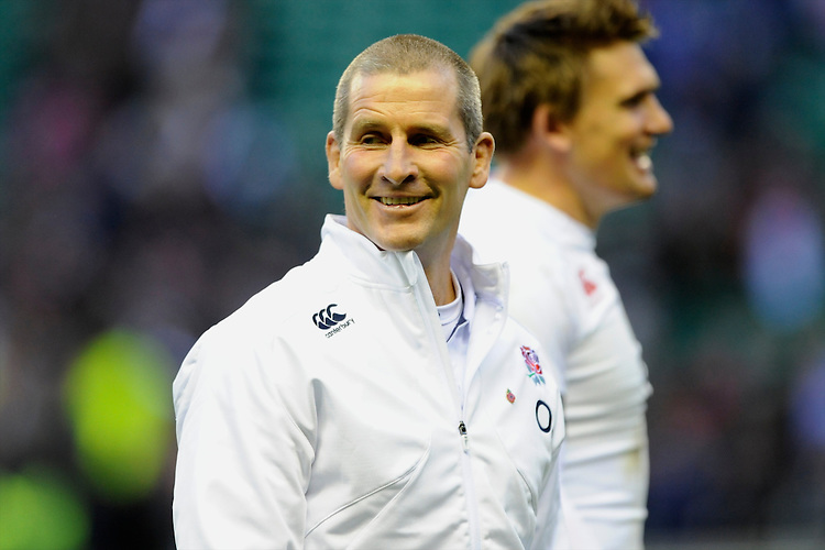 Stuart Lancaster, England Team Manager, looks pleased after winning the QBE Autumn International match for the Cook Cup between England and Australia at Twickenham on Saturday 2nd November 2013 (Photo by Rob Munro)