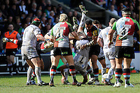Julian Salvi of Leicester Tigers is spear-tackled by Maurie Fa'asavalu of Harlequins during the Aviva Premiership match between Harlequins and Leicester Tigers at The Twickenham Stoop on Saturday 21st April 2012 (Photo by Rob Munro)