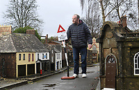 BNPS.co.uk (01202 558833)<br /> Pic: ZacharyCulpin/BNPS<br /> <br /> Pictured: Pictured: Manager Nick Clark with one of the signs<br /> <br /> A popular model village has installed 1950s style road signs in a bid to ensure social distancing.<br /> <br /> Wimborne Model Town in Dorset is due to open back up to the public at the end of March and was desperate to adhere to government guidelines.