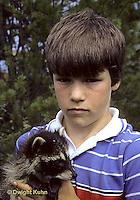 MA25-073z  Boy with raccoon.
