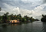 A houseboat floats on the backwaters in Alleppey, Kerala.