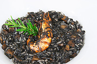 Seafood risotto with black rice coloured with octopus inc, a grilled shrimp gambas from the luxury Excelsior Hotel and Spa restaurant terrace Dubrovnik, old city. Dalmatian Coast, Croatia, Europe.