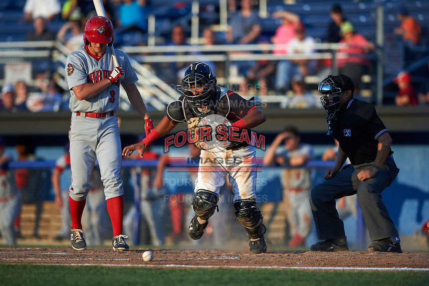 Batavia Muckdogs catcher Brad Haynal (23) retrieves a blocked pitch in between Andrew Stevenson (3) and umpire David Martinez during a game against the Auburn Doubledays July 10, 2015 at Dwyer Stadium in Batavia, New York.  Auburn defeated Batavia 13-1.  (Mike Janes/Four Seam Images)