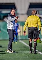 26 October 2019: University of Vermont Catamounts Head Coach Rob Dow has words with an official during play against the University of Massachusetts Lowell River Hawks at Virtue Field in Burlington, Vermont. The Catamounts rallied to defeat the River Hawks 2-1, propelling the Cats to the America East Division 1 conference playoffs. Mandatory Credit: Ed Wolfstein Photo *** RAW (NEF) Image File Available ***