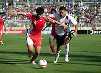 China's Zhang Yaokun battles USA's Clint Dempsey for the ball. The USA defeated China, 4-1, in an international friendly at Spartan Stadium, San Jose, CA on June 2, 2007.