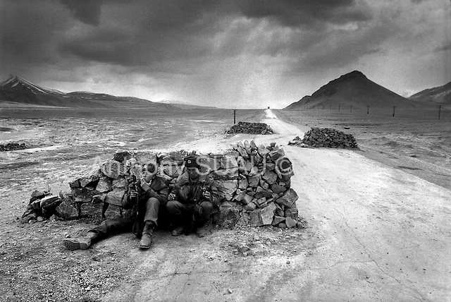 "Horag-Osh Road, Tajikistan .1996.Russian border guards monitor the old silk road which has become a main route for Afghan grown opium since the fall of the former Soviet Union. Soldiers search tranport trucks for hidden ""hannka"" or raw opuim.."