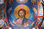 A Byzantine-style Pantocrator of Jesus Christ looms over iconographer Miloje Milinkovic's icons and frescos painted on the wall of historic St. Sava Orthodox Church, Jackson, Calif.