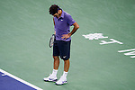 SHANGHAI, CHINA - OCTOBER 17:  Roger Federer of Switzerland reacts after losing a point against Andy Murray of Great Britain during their singles final match during day seven of the 2010 Shanghai Rolex Masters at the Shanghai Qi Zhong Tennis Center on October 17, 2010 in Shanghai, China.  (Photo by Victor Fraile/The Power of Sport Images) *** Local Caption *** Roger Federer