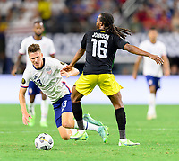 DALLAS, TX - JULY 25: Matthew Hoppe #13 of the United States is tripped up by Daniel Johnson #16 of Jamaica while going for the ball during a game between Jamaica and USMNT at AT&T Stadium on July 25, 2021 in Dallas, Texas.