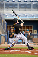 FCL Pirates Black catcher Henry Davis (32) flies out to centerfield in the top of the first inning during a game against the FCL Rays on August 3, 2021 at Charlotte Sports Park in Port Charlotte, Florida.  Davis was making his professional debut after being selected first overall in the MLB Draft out of Louisville by the Pittsburgh Pirates.  (Mike Janes/Four Seam Images)
