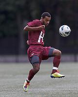 Harvard University midfielder Andrew Wheeler-Omiunu (18) clears the ball. Boston College (white) defeated Harvard University (crimson), 3-2, at Newton Campus Field, on October 22, 2013.