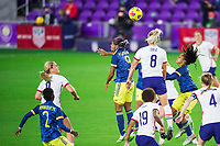 ORLANDO, FL - JANUARY 18: Julie Ertz #8 of the USWNT heads a ball during a game between Colombia and USWNT at Exploria Stadium on January 18, 2021 in Orlando, Florida.