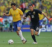 Kaka (8) of Brazil is marked by Mile Sterjovski (21) of Australia. Brazil defeated Australia, 2-0, in their FIFA World Cup Group F match at the FIFA World Cup Stadium, Munich, Germany, June 18, 2006.