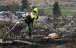 Firefighters extinguish a one-acre brush fire near Highway 88 and Diamond Valley Road just north of Woodfords, Ca. on Monday, Aug. 29, 2011..Photo by Cathleen Allison