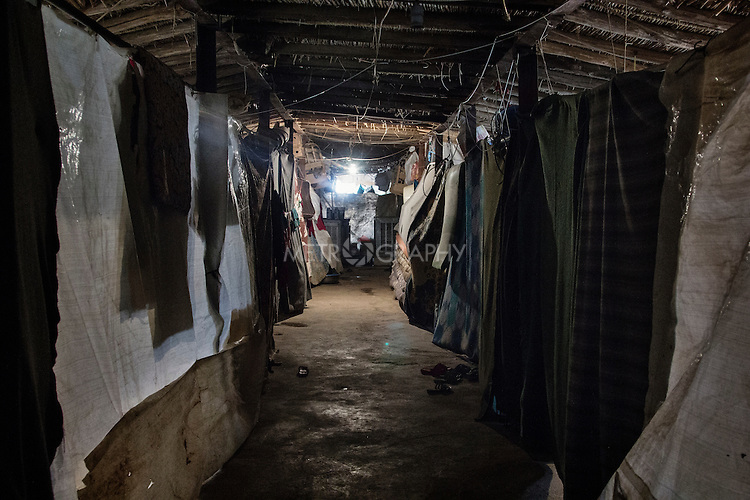 23/06/2015 -- Dibaga-Makhmur-, Iraq -- A view of the chicken farm where IDP's from Jarallah are being hosted after ISIS took control of their village and areas around it. Inside the building they divided the space by hanging tarpaulins so that each family could have a little privacy.