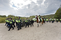 Pictured: Police officers move away confiscated sound equipment. Monday 31 August 2020<br /> Re: Around 70 South Wales Police officers executed a dispersal order at the site of an illegal rave party, where they confiscated sound gear used by the organisers in woods near the village of Banwen, in south Wales, UK.