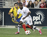 Eddie Johnson #9 of the USA MNT shields the ball from Mario Yepes #3 of Colombia during an international friendly match at PPL Park, on October 12 2010 in Chester, PA. The game ended in a 0-0 tie.