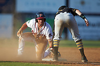 Carlos Baerga Jr. (2) of the Danville Braves keeps his hand on the bag as Bristol Pirates third baseman Dean Lockery (12) applies a tag at American Legion Post 325 Field on July 1, 2018 in Danville, Virginia. The Braves defeated the Pirates 3-2 in 10 innings. (Brian Westerholt/Four Seam Images)