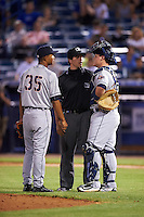 Lakeland Flying Tigers catcher Kade Scivicque (28) and pitcher Johan Belisario (35) question a call with umpire Mike Savakinas during a game against the Tampa Yankees on April 8, 2016 at George M. Steinbrenner Field in Tampa, Florida.  Tampa defeated Lakeland 7-1.  (Mike Janes/Four Seam Images)