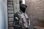 20/07/14  Iraq -- Daquq, Iraq -- A portrait of peshmerga at the base in Daquq.