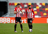 14th February 2021; Brentford Community Stadium, London, England; English Football League Championship Football, Brentford FC versus Barnsley; Vitaly Janelt and Saman Ghoddos of Brentford discuss tactics