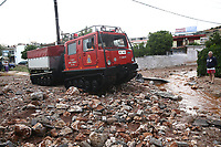 Pictured: A specialist fire vehicle used to access flooded areas covered by debris in the Magoula area, in the outskirts of Athens, Greece. Wednesday 27 June 2018<br /> Re: Flashflooding has been caused by storm Nefeli in parts of Greece.