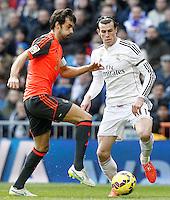 Real Madrid's Garet Bale (r) and Real Sociedad's Xabi Prieto during La Liga match.January 31,2015. (ALTERPHOTOS/Acero) /NortePhoto<br /> /NortePhoto.com